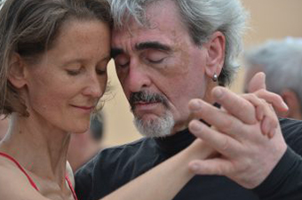 Man and woman dancing closely with their eyes closed