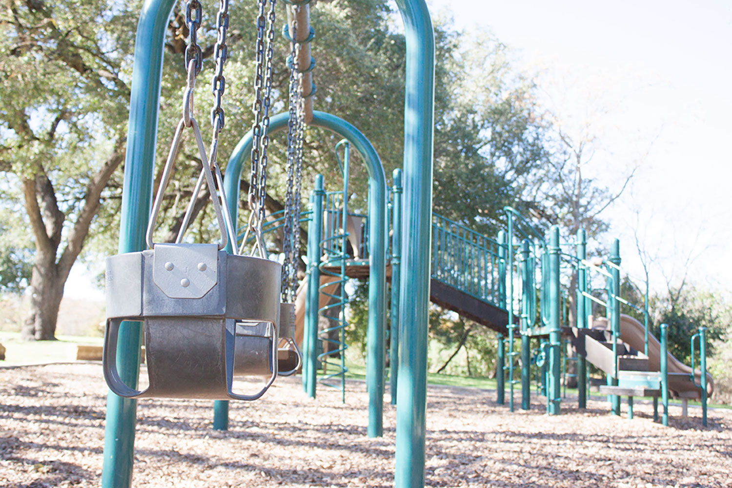 Swingset and playscape at Chautauqua Park in Georgetown, TX