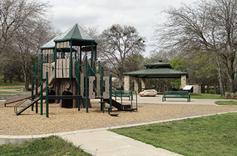 The playscape and pavilion at Rivery Park in Georgetown, TX