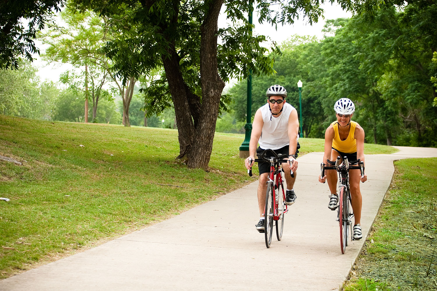 Man and woman riding bikes along the hike and bike trail in Georgetown, TX