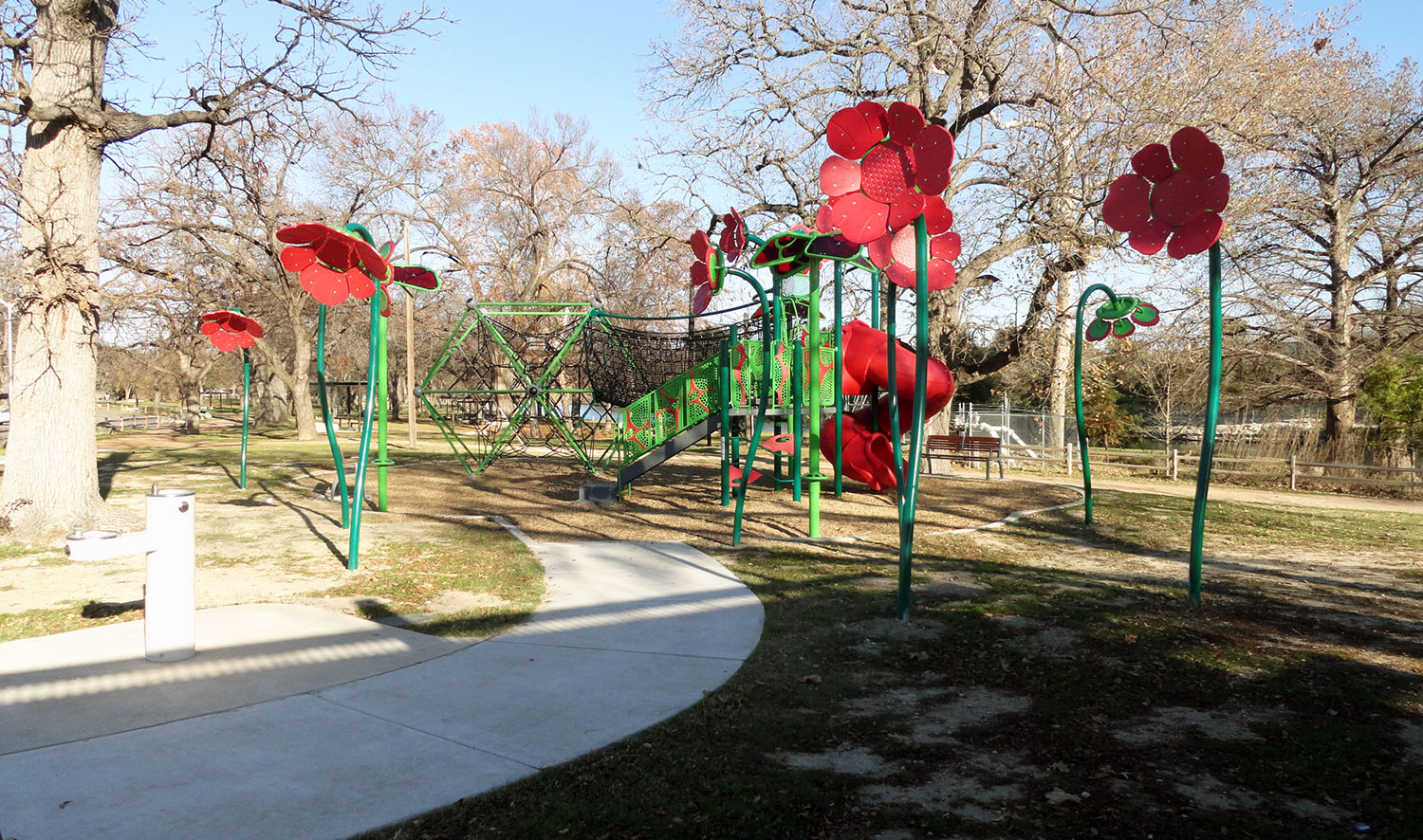 Red Poppy-themed playground in San Gabriel Park in Georgetown, TX