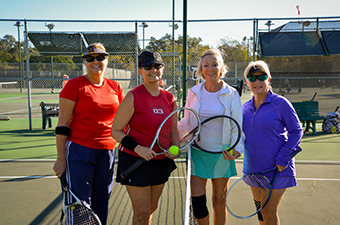 Women gathered at the tennis net at the Georgetown Tennis Center in Georgetown, TX