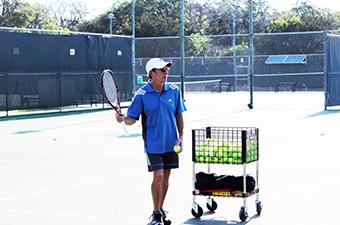 Pete Polkinghorn, Head Pro at the Georgetown Tennis Center, serving tennis balls.