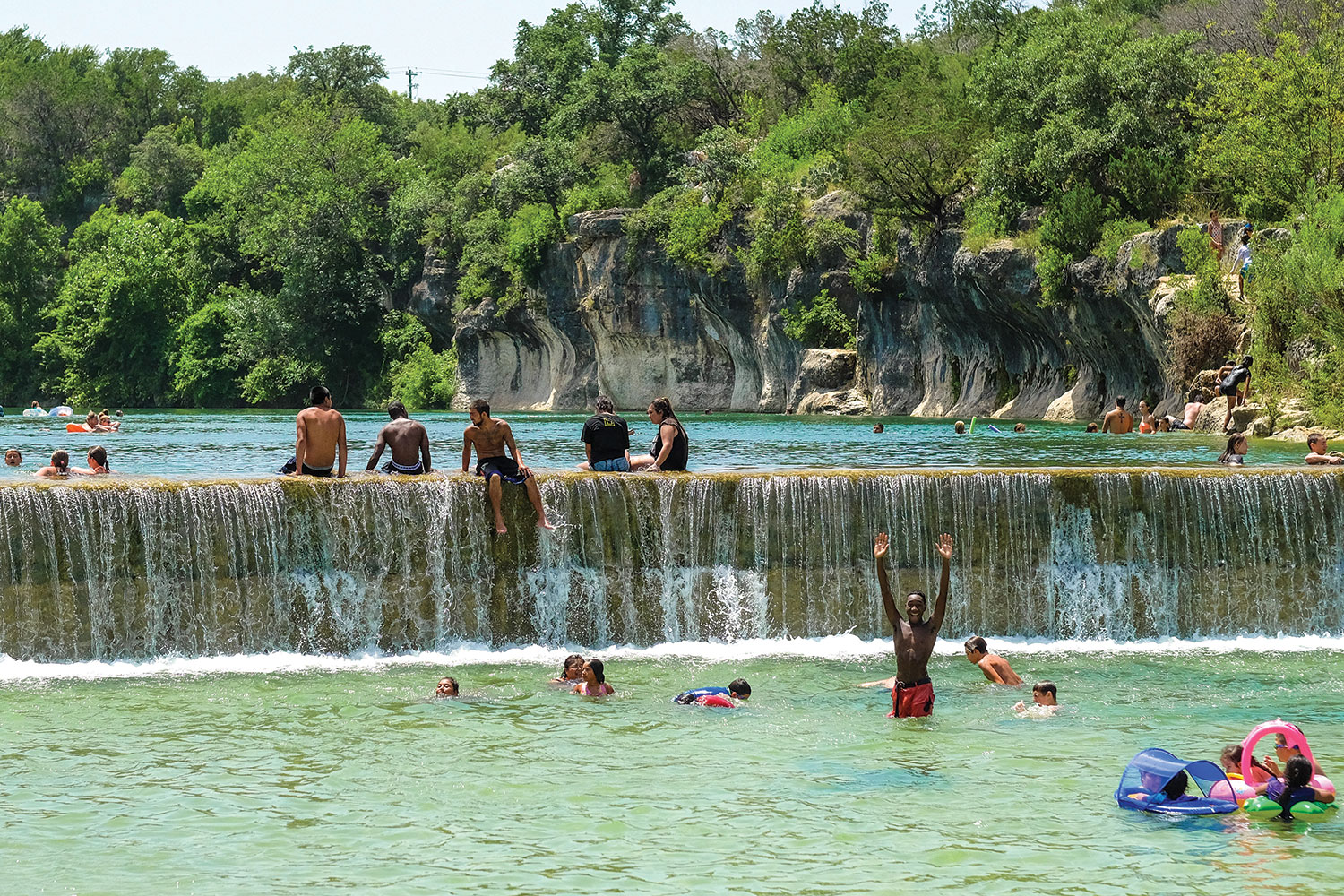 People swimming at Blue Hole Park in Georgetown, TX