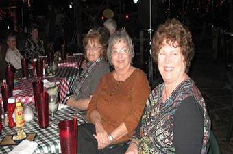 Group of senior citizens sitting at restaurant tables