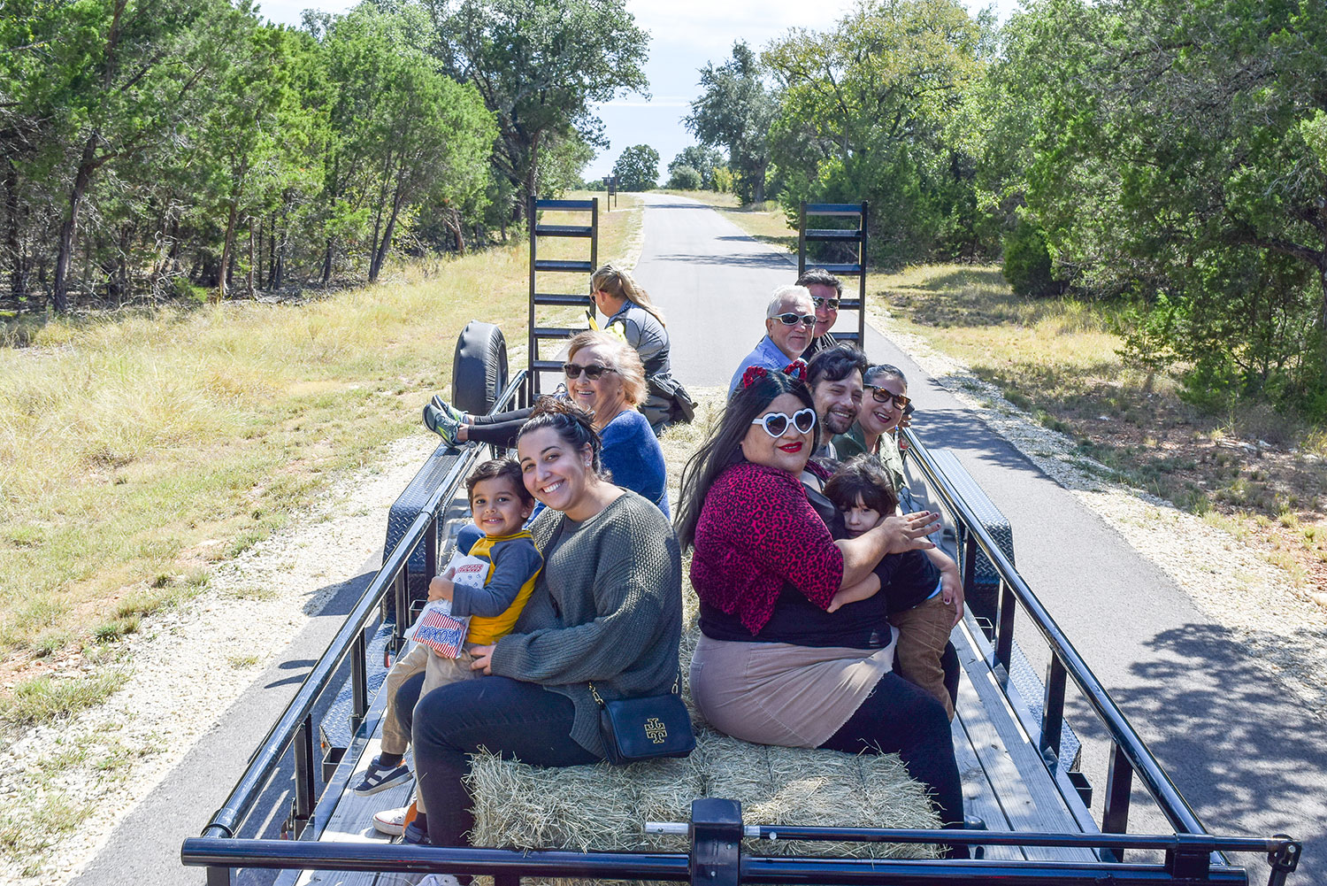 Group of people riding in a hayride at Hay Day at Garey Park