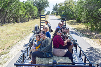 Group of people riding on a hayride at Hay Day at Garey Park