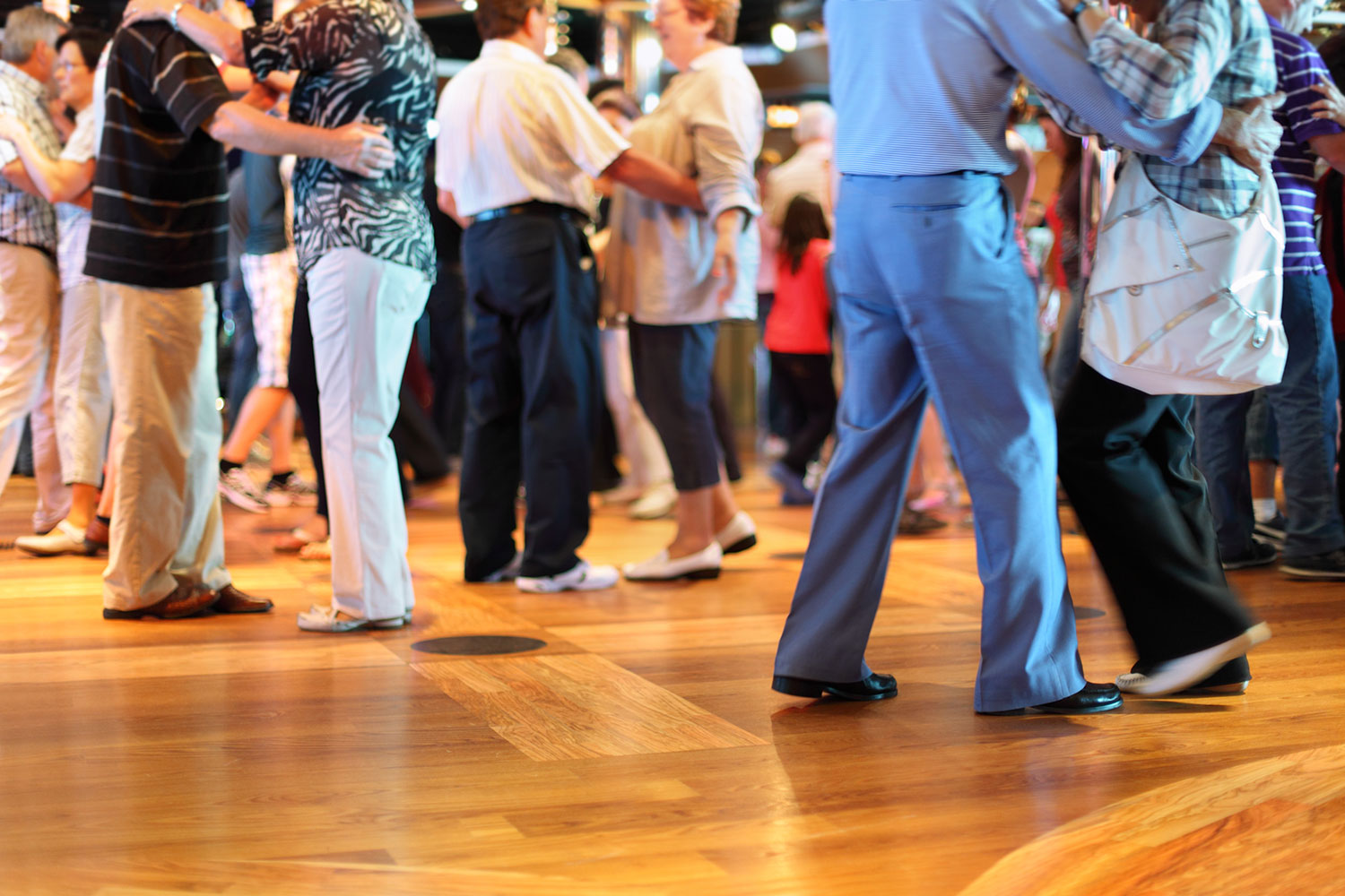 Group of senior adults slow dancing