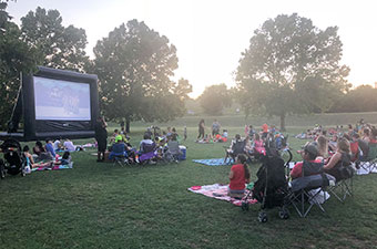 Group of people watching a movie on an inflatable screen