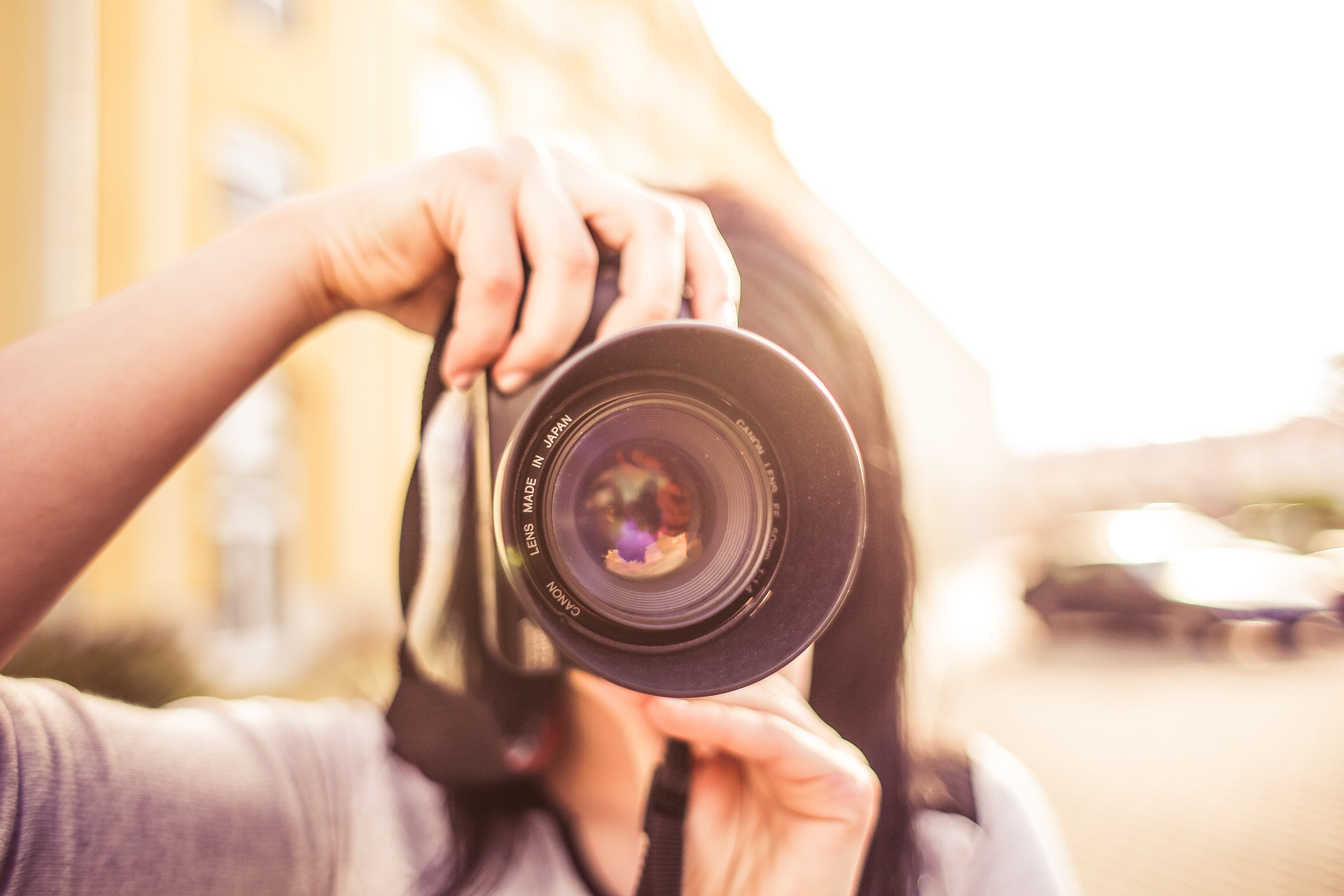 Woman holding a camera to her face
