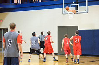 Men playing basketball at the Georgetown Recreation Center