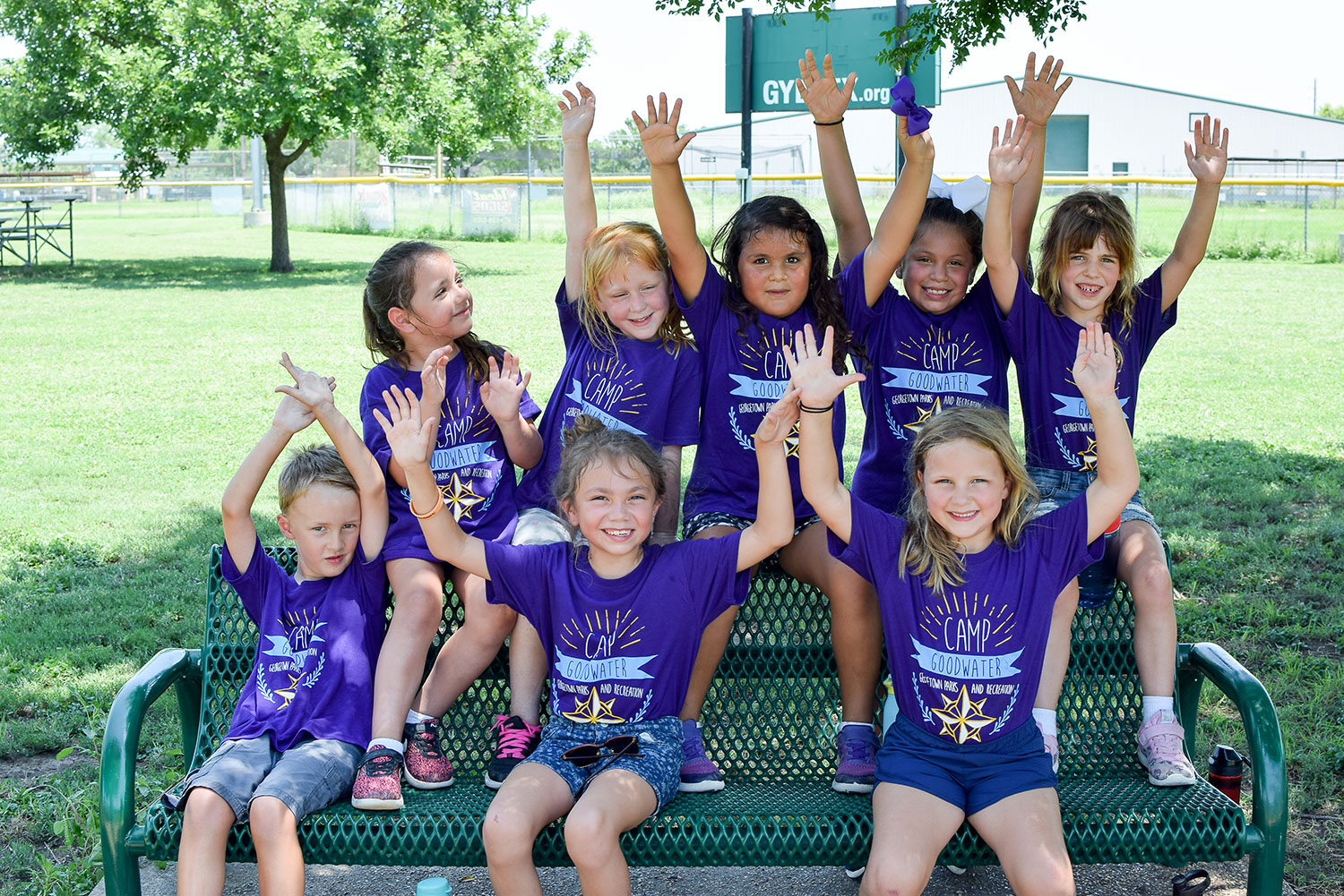 Group of children wearing purple shirts at Camp Goodwater in Georgetown, TX