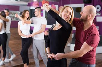 Two couples ballroom dancing