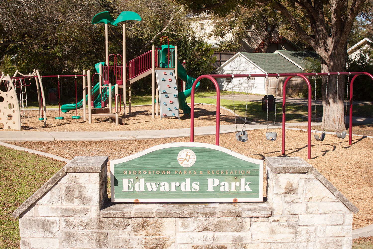 Entrance to Edwards Park in Georgetown, TX with playscape in the background