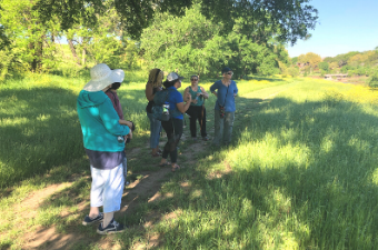 Group of people on a guided walk at Garey Park in Georgetown, TX