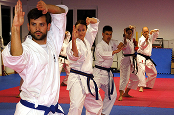 Martial Arts class participants lined up on the mat