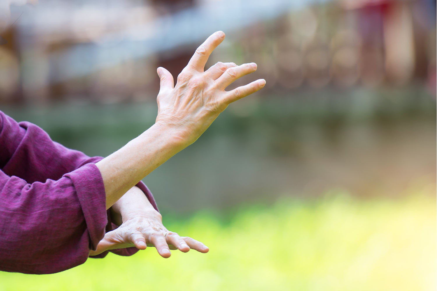 View of a woman's hands as she practices Tai Chi