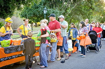 People in line visit vendor booths at the Halloween Festival in Georgetown, TX