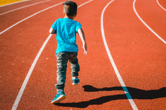 Kid running on a track