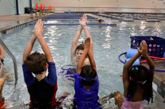 Children participate in a swim lesson at the Georgetown Recreation Center indoor pool
