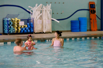 Mother and daughter participate in swim lessons at the Georgetown Recreation Center indoor pool