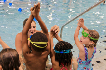 Group of children participate in swim lessons at the Georgetown Recreation Center indoor pool