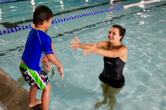 Child participates in a swim lesson at the Georgetown Recreation Center indoor pool