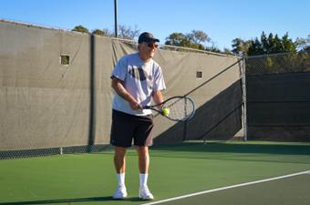 Man preparing to serve a tennis ball at the Georgetown Tennis Center