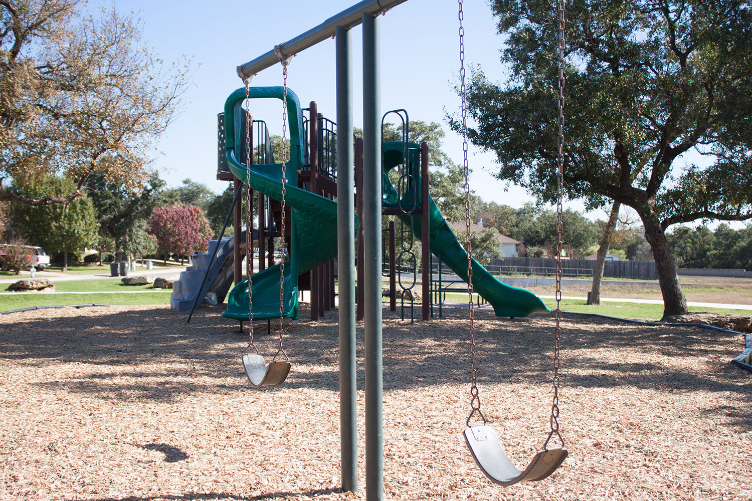 Swingset and playscape at Woodlake Park in Georgetown, TX
