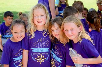 Four girls wearing purple Camp Goodwater shirts