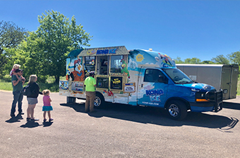 Kona Ice truck serving guests at an event at Garey Park in Georgetown, TX
