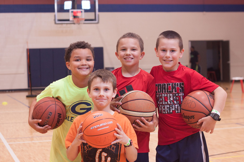 Four boys holding basketballs