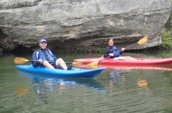 Seniors kayaking at Blue Hole in Georgetown, TX