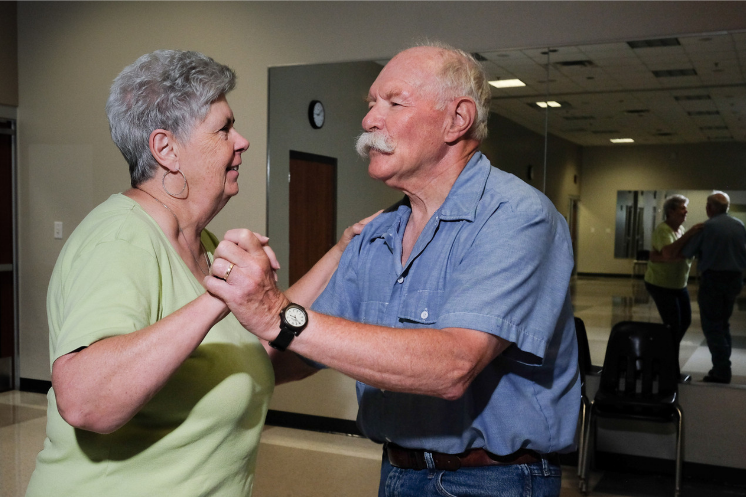 Senior couple dancing closely